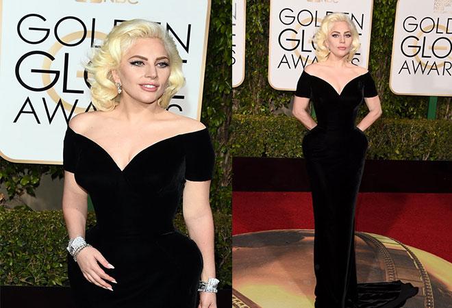 Siyah elbisesi ve ihtişamlı mücevherleri ile 2016 Altın Küre ödül töreninde Lady Gaga.
